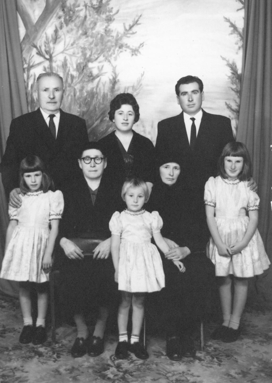 The Boshkoff, Dzodzoff, and Gligoroff families in Australia. (L to R): Vouiko Koleto Boshkoff, Vouina Anna Boshkova, Ditchka (Dzodzova) Gligorova, Prosha (Boshkova) Dzodzova, and Atanas Gligoroff the husband of Ditchka from Bamboki. The three girls standing in front are the daughters of Atanas and Ditchka Gligoroff.