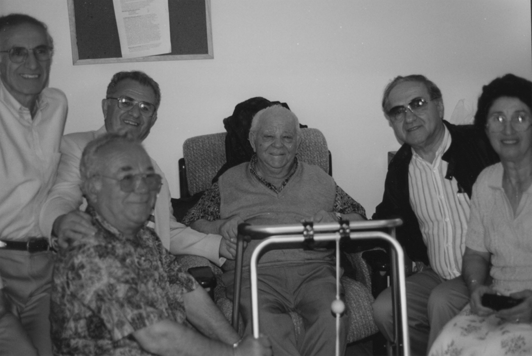 At the Nursing home where Vaneto Pizarcoff is staying in Melbourne, Australia. (L to R): My brother Vaneto (Popoff) Pappas, Tashko Pizarcoff,I, Vaneto Pizarcoff, Yorgi Bellioff, and my sister Eleftheria (Popova) Mitchell (Pappakonstantinou).